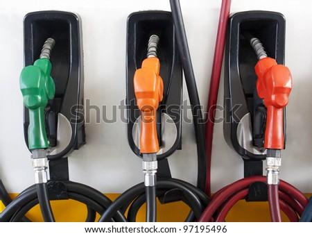 Three Gas Pump Nozzles at Gas Station - stock photo