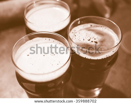Three pints of beer alcoholic drink vintage - stock photo