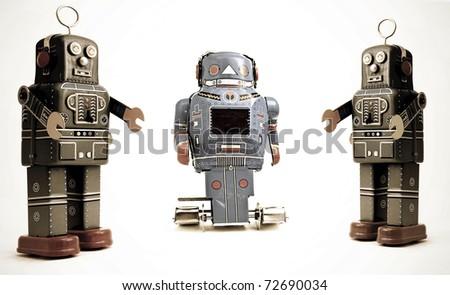 three retro robots - stock photo