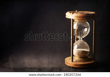 time concept with hourglass lying toned in warm black and white