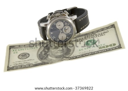 Time is money. Watch and hundred dollars banknote - stock photo