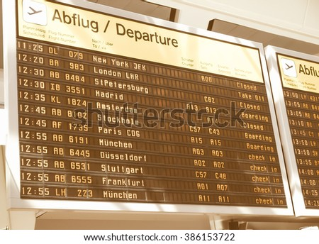 Timetable display screen of arrivals and departures at station or airport vintage