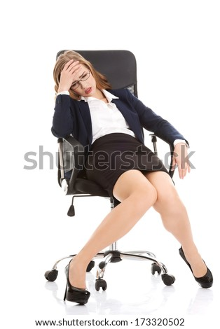 Tired business woman on a chair. Isolated on white. - stock photo