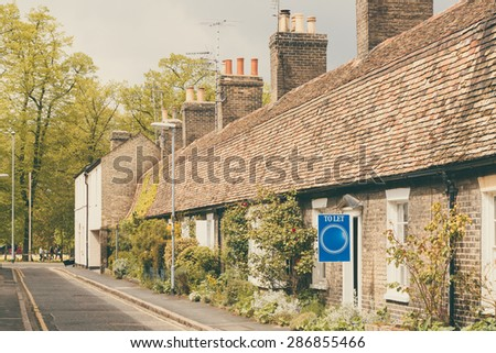 'To Let' sign beautiful row of cottages, Cambridge, England - stock photo