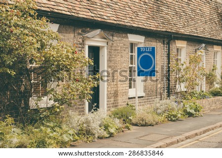 'To Let' sign outside Cottage for rent in English countryside - stock photo