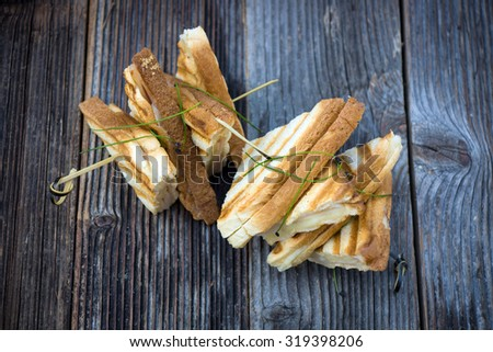 Toast sandwiches with ham on the wooden board.  - stock photo