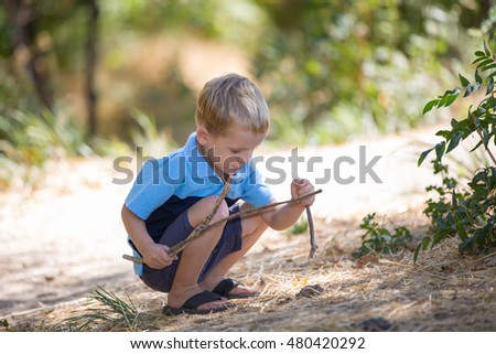 toddler boy having fun outside in the park. Cute happy boy child outdoors