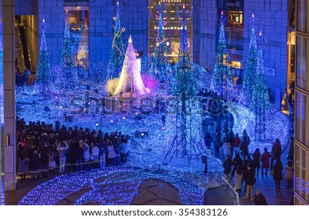 Tokyo, Japan - Dec 12, 2015: People visiting a shopping center with Christmas illumination light show  in Tokyo. - stock photo