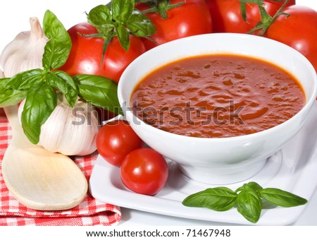 tomato soup with basil leaves and vegetables - stock photo