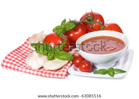 tomato soup with basil leaves and vegetables on white background - stock photo