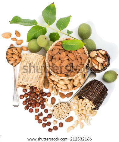 top view of assortment of nuts isolated on white background  - stock photo