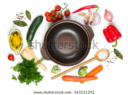 Top view of open pan, fresh raw vegetable and spices for soup isolated on white background - stock photo