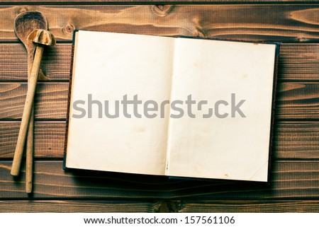 top view of recipe book with stirring spoons - stock photo