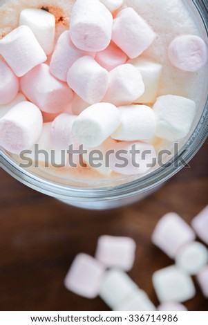 Top view to the  marshmallows in hot chocolate  in the glass - stock photo