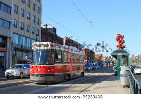 TORONTO, ON, February 9: Spadina street in Chinatown showing city transportation streetcar. The TTC operates the third most heavily used urban mass transit system - stock photo