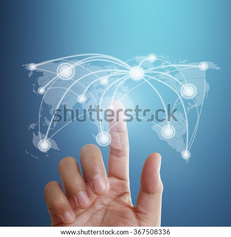 touching virtual icon of social network - stock photo