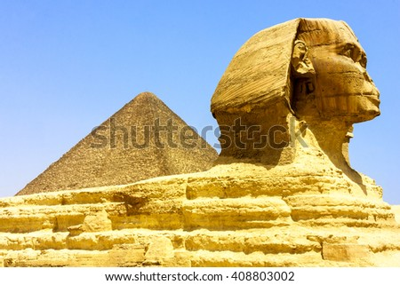 Tourists and locals equally like to visit the Pyramids and Sphinx at Giza, Egypt. The world's oldest tourist attraction, the Pyramids of Giza are 5000 years old.  - stock photo