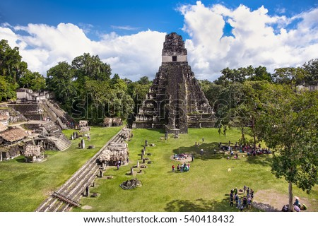 Tourists at the Gran Plaza at the archaeological site Tikal, Guatemala.