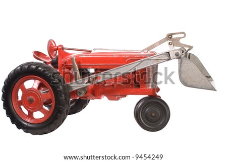 toy farm tractor. - stock photo