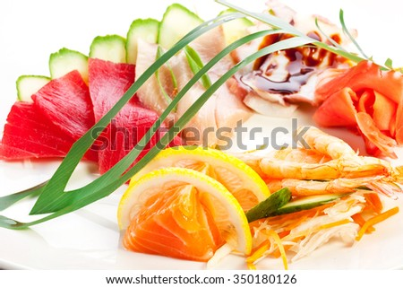 Traditional japanese food. Raw seafood with garnish.