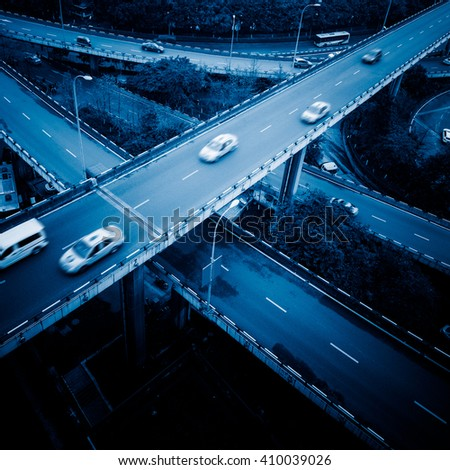 traffic on chongqing caiyuanba overpass,blue toned image. - stock photo