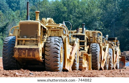 """Train"" of heavy construction equipment - stock photo"