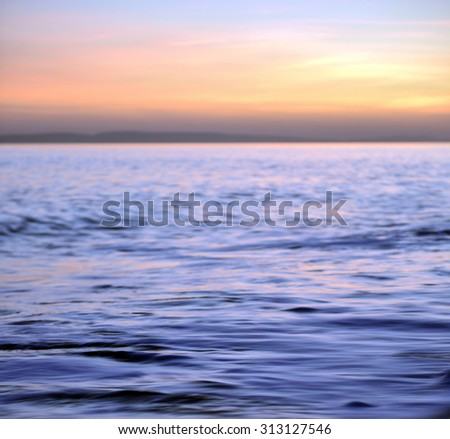 Tranquil calm water on a summer evening off the Dorset coast  - stock photo