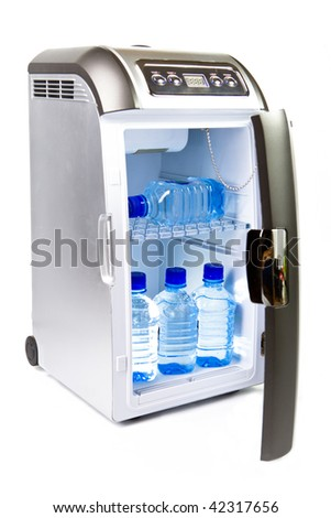 traveling automobile refrigerator with bottles of water - stock photo