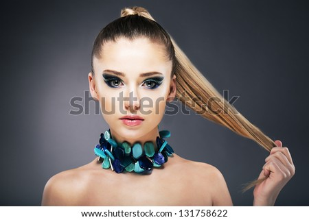 Treatment. Woman holding Tips of her long faint Hair in hand - stock photo