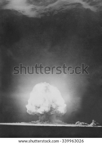 'Trinity' explosion at Los Alamos, Alamogordo, New Mexico. July 16, 1945. Photograph taken 9 seconds after the initial Trinity detonation shows the Mushroom cloud. Manhattan Project, World War 2. - stock photo