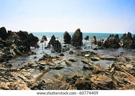 Tropical rocky beach in Arambol, Harmal, Goa, India - stock photo