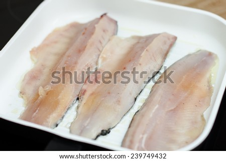 Trout Fish Fillets in a pan ready for grilling. - stock photo