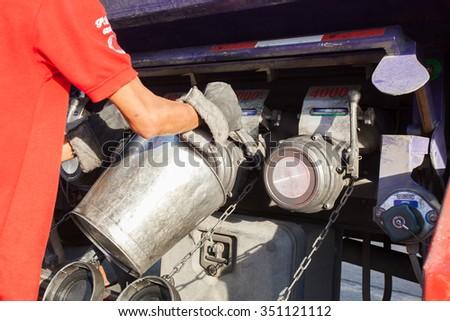 Truck Driver Drain oil were to determine - stock photo
