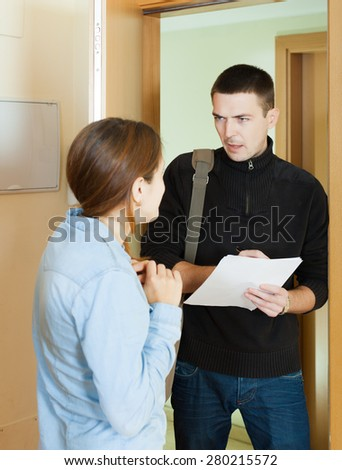 trying to collect money from housewife - stock photo