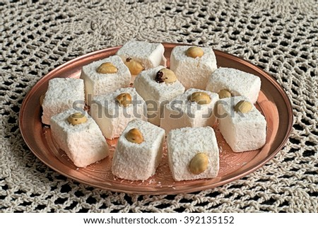 Turkish delight on a tray made of copper on a napkin