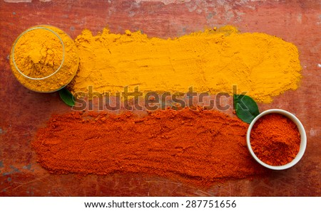 (Turmeric, Paprika) Spices and herbs on wood background, Top view indian spices and herbs difference ware on wood background with copy space for design spices, herbs or foods content. - stock photo