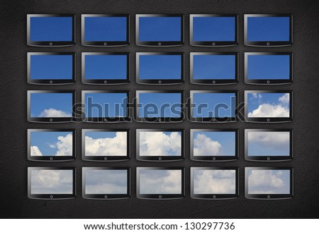 tv wall with sky on it - stock photo