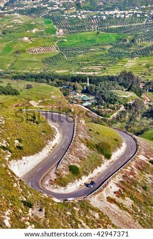 Twisting mountain road on border of Israel and Jordan - stock photo