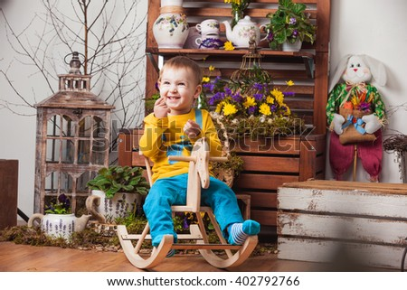 Two brothers young boys in identical T-shirts on the background of spring colors , elegant d?cor and play . - stock photo