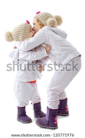 Two little girls embrace - stock photo