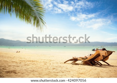 Two lounge chair at tropical beach, relaxation next sea  - stock photo