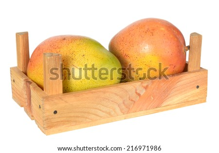 two Mexican mango in crate isolated on white