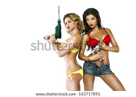 Two sexy girl holding a power drill - stock photo