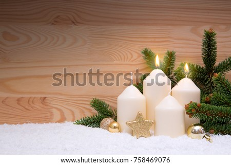 Two white burning candle for the second advent. Second Advent.