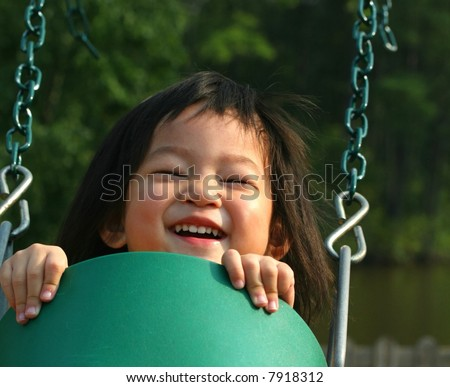 two-year-old girl on swing - stock photo
