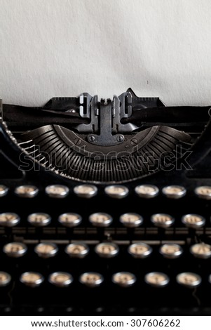 typewriter with aged textured paper sheet