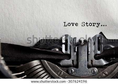 typewriter with white paper. love story sign - stock photo