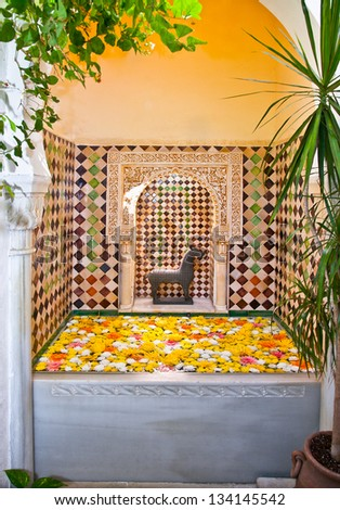 Typical arab spa with flowers in Cordoba, Andalusia, Spain. - stock photo