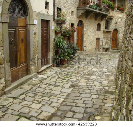 typical  italian narrow street,borgo Montefioralle, sometimes claimed to be the birthplace of Amerigo Vespucci, Greve in Chianti, Italy, Europe - stock photo