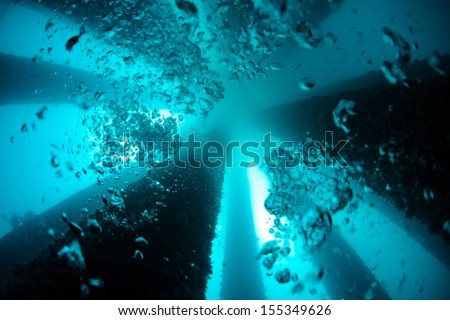 underwater oil rig  - stock photo